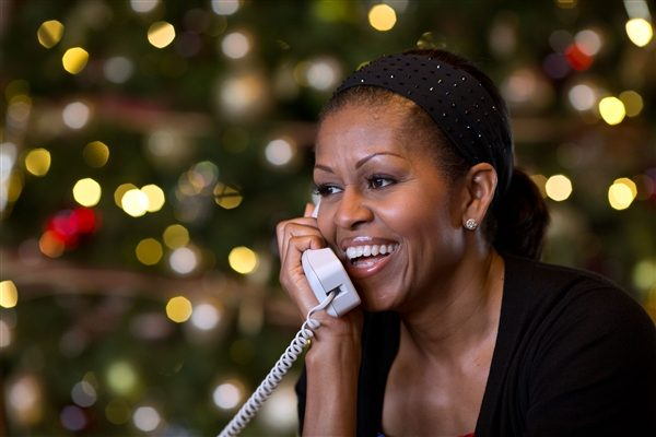 From last photo of President Obama, this is Michelle Obama on the phone in front of Christmas lights.  Is he engaging with incoming leads or something else?