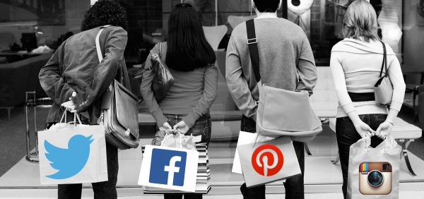 4 people with shopping bags with the logo of social media channels like twitter, facebook, pinterest and instagram to represent social media shopping haul