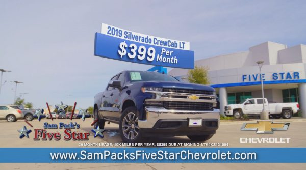 Chevrolet Silverado In front of the dealership.